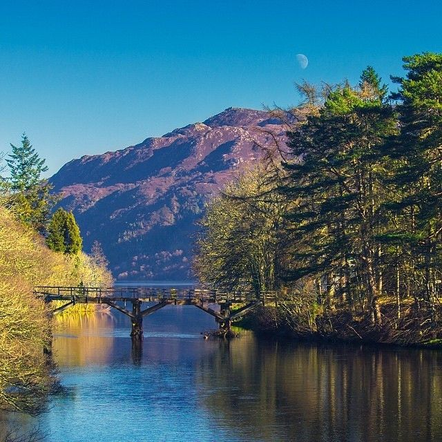 """#LochNess looks amazing in this photo from @djinnster, set against the beautiful scenery with the moon up above! #brilliantmoments #visitscotland"""