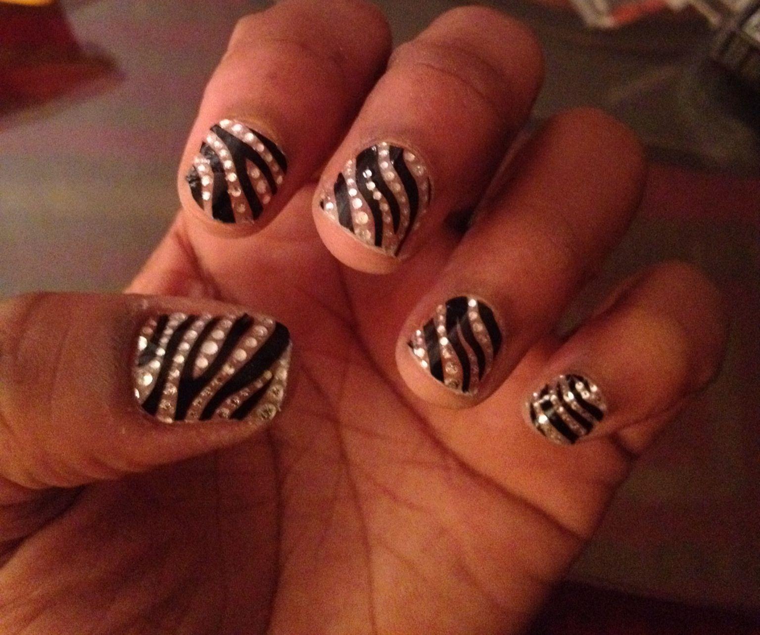 Zebra print and rhinestone nails