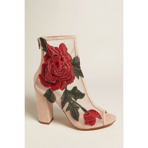 860e98c9844 A pair of sheer mesh ankle boots featuring faux suede trim, a open toe,  side floral embroidered applique, a back zip closure, and a covered block  heel.