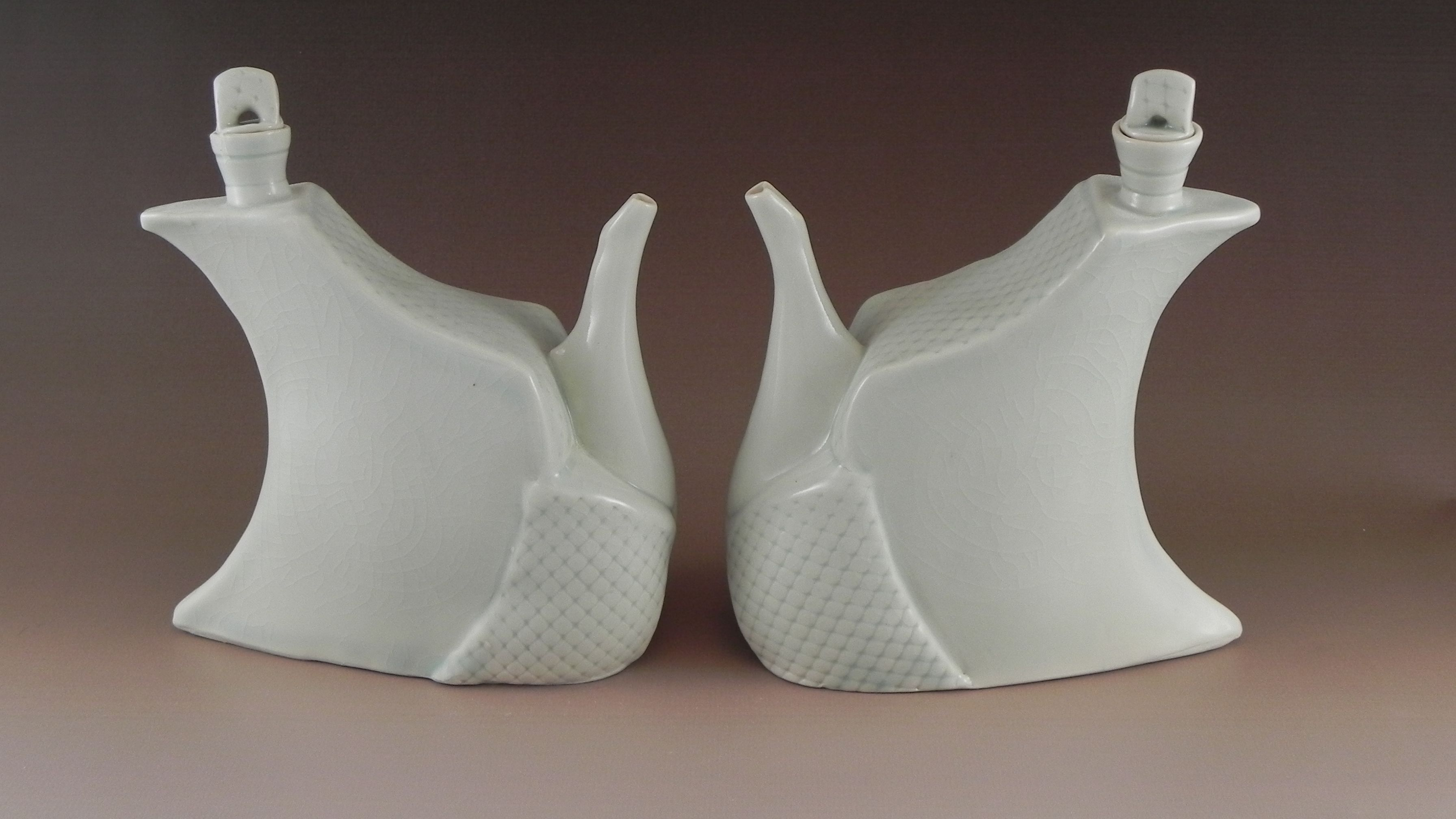 thrown and altered oil and vinegar porcelain set
