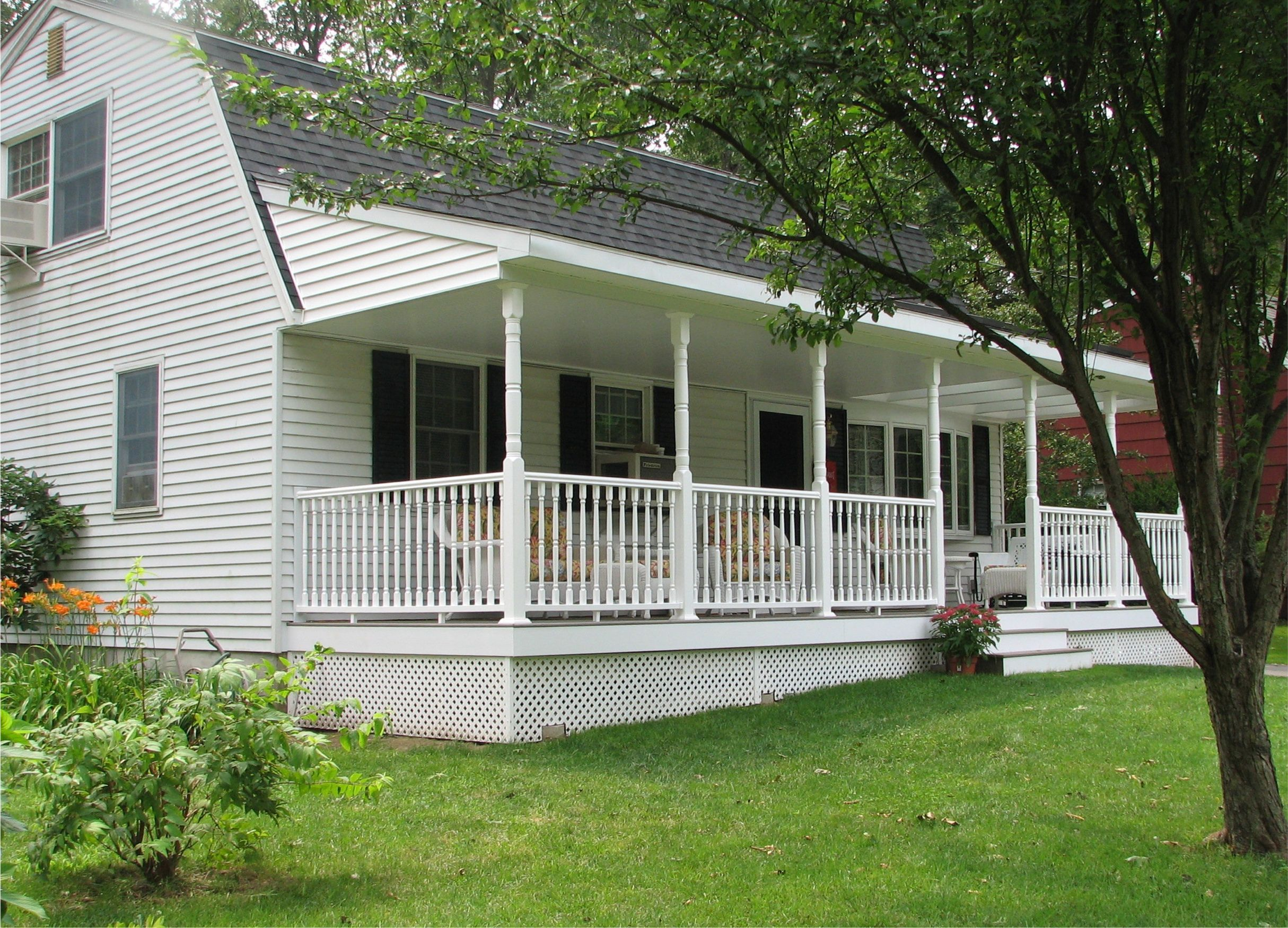 Front porch split level house to a shallow pitch at for Front porch deck designs