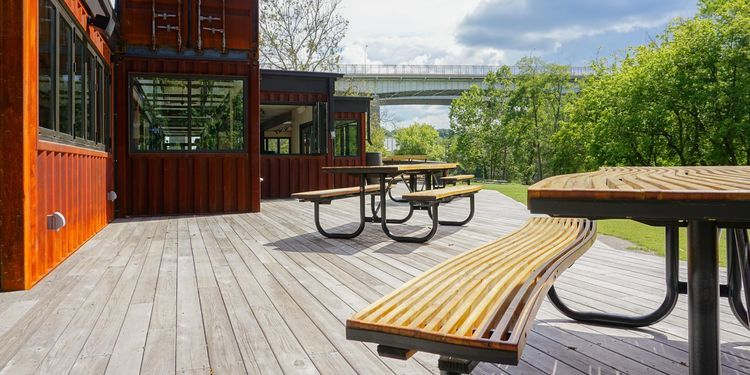 Cypress deck and Trex outdoor furniture of shipping container restaurant in  Asheville, North Carolina - Cypress Deck And Trex Outdoor Furniture Of Shipping Container