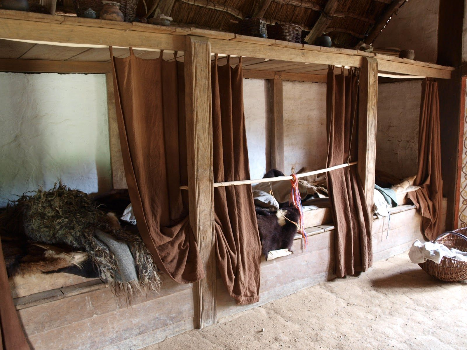 Beds With Curtains And Storage Above Viking Longhouse
