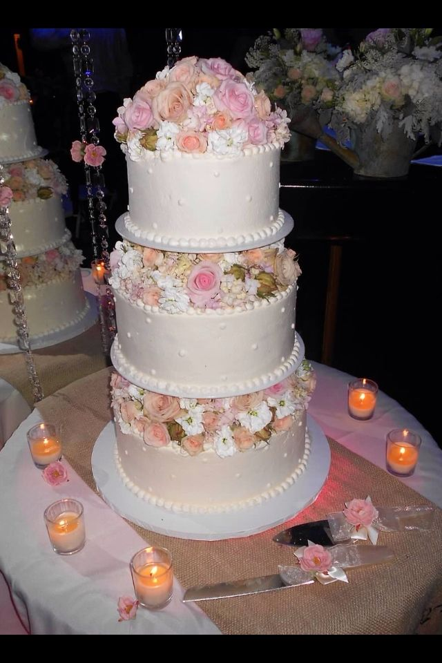 Our wedding cake with fresh flowers, whipped cream frosting and ...