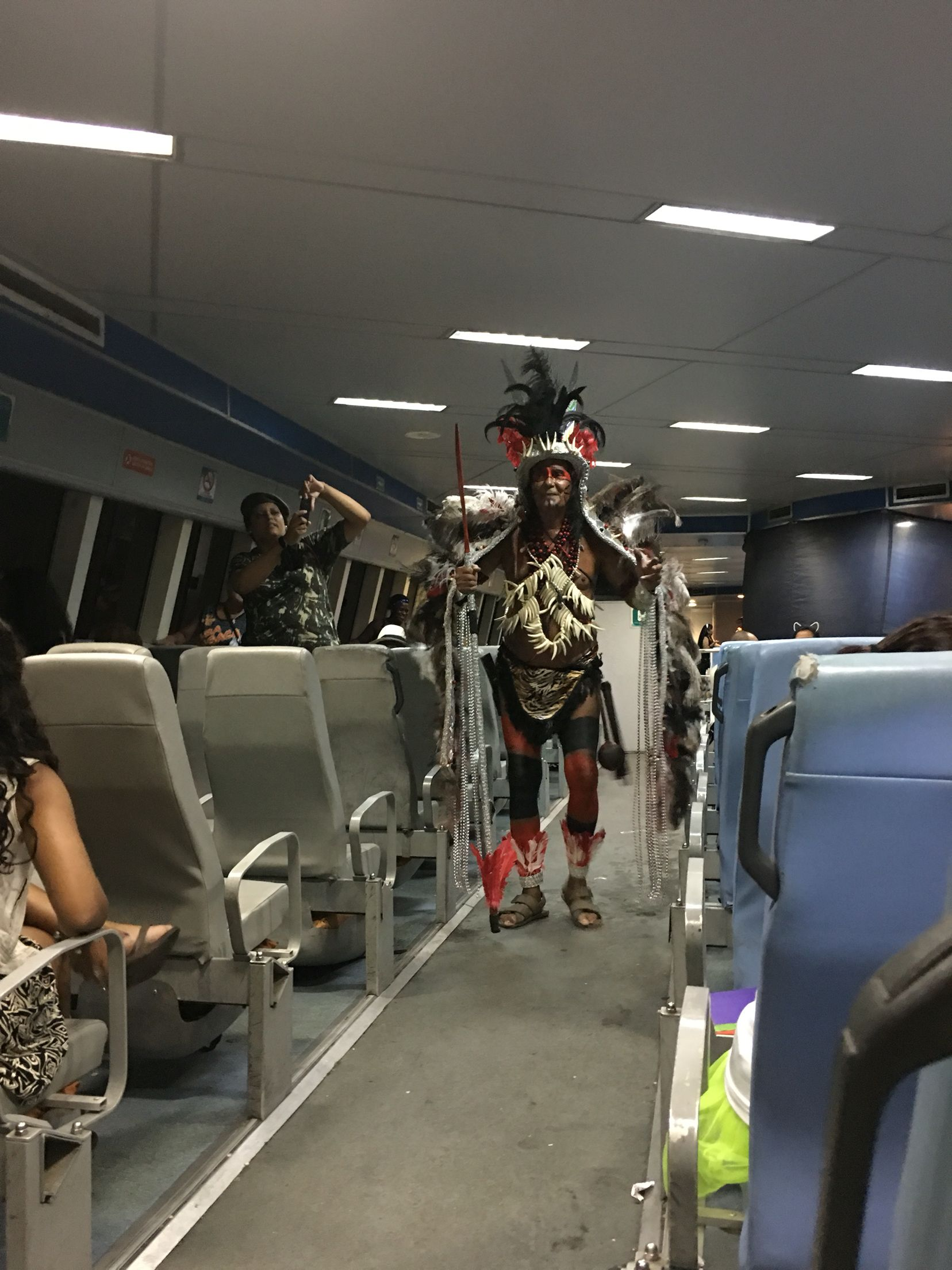 It was quite the surprise, I was on the ferry from Niterói to Rio, when all of a sudden this Indian stared to sing and dance. After a while the entire deck was singing and making beats from anything they could touch.