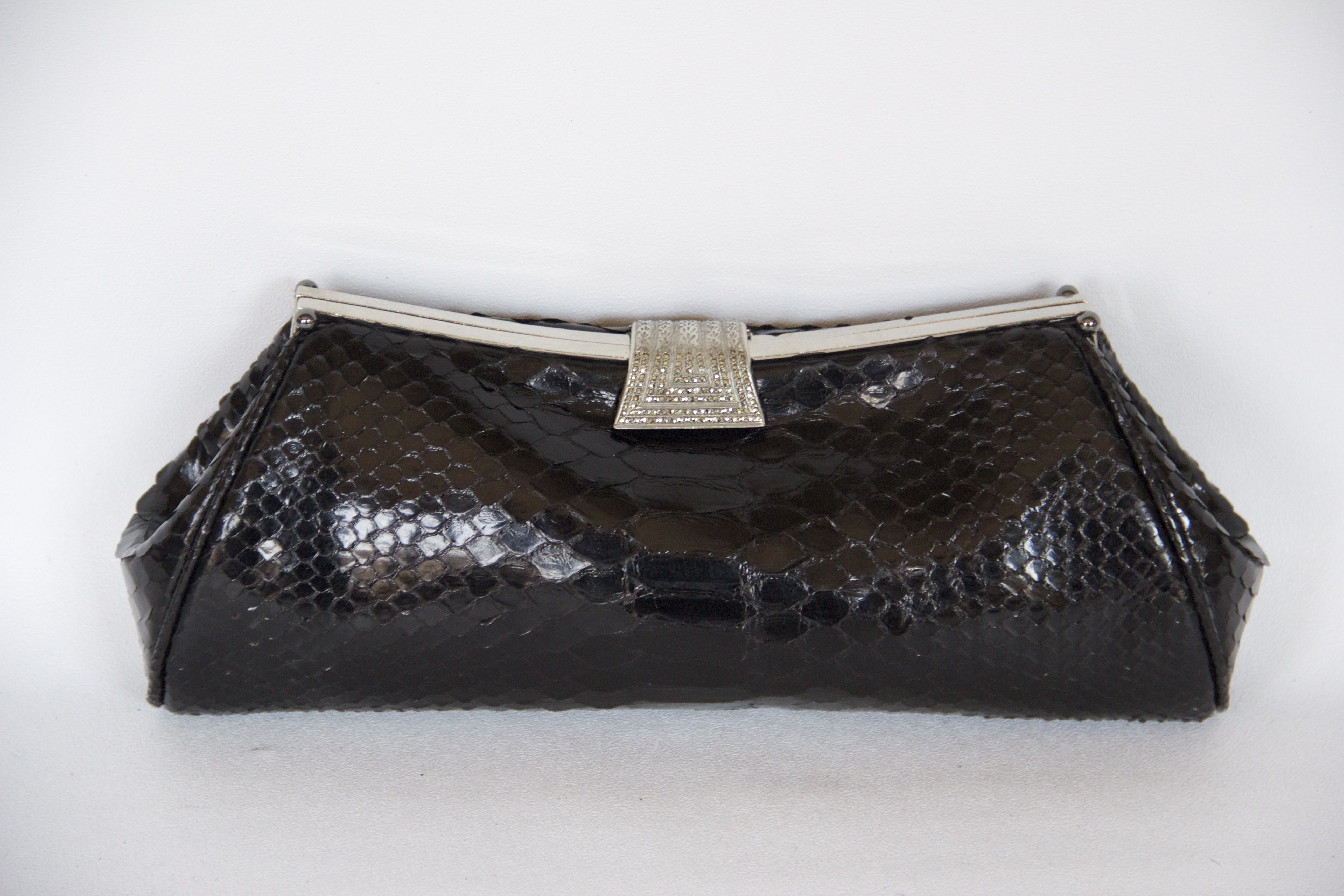 Black glazed python clutch with silver clasp. I love the unique shape!