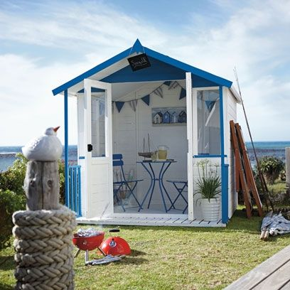 Blue and white nautical inspired garden shed more ways for Beach hut designs