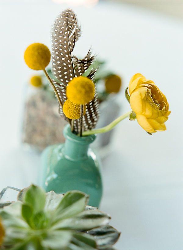 Aqua vase, yellow flowers