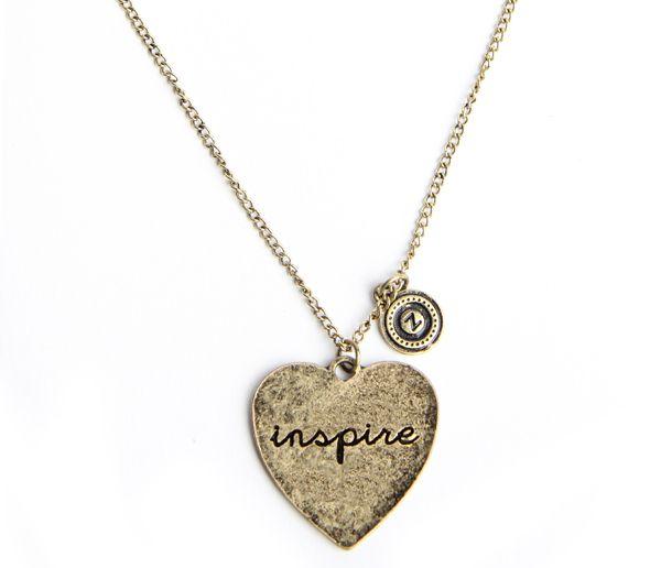 Goudkleurige JWLZ schakelketting met een hart met de tekst 'Inspire'. www.JWLZ.nl
