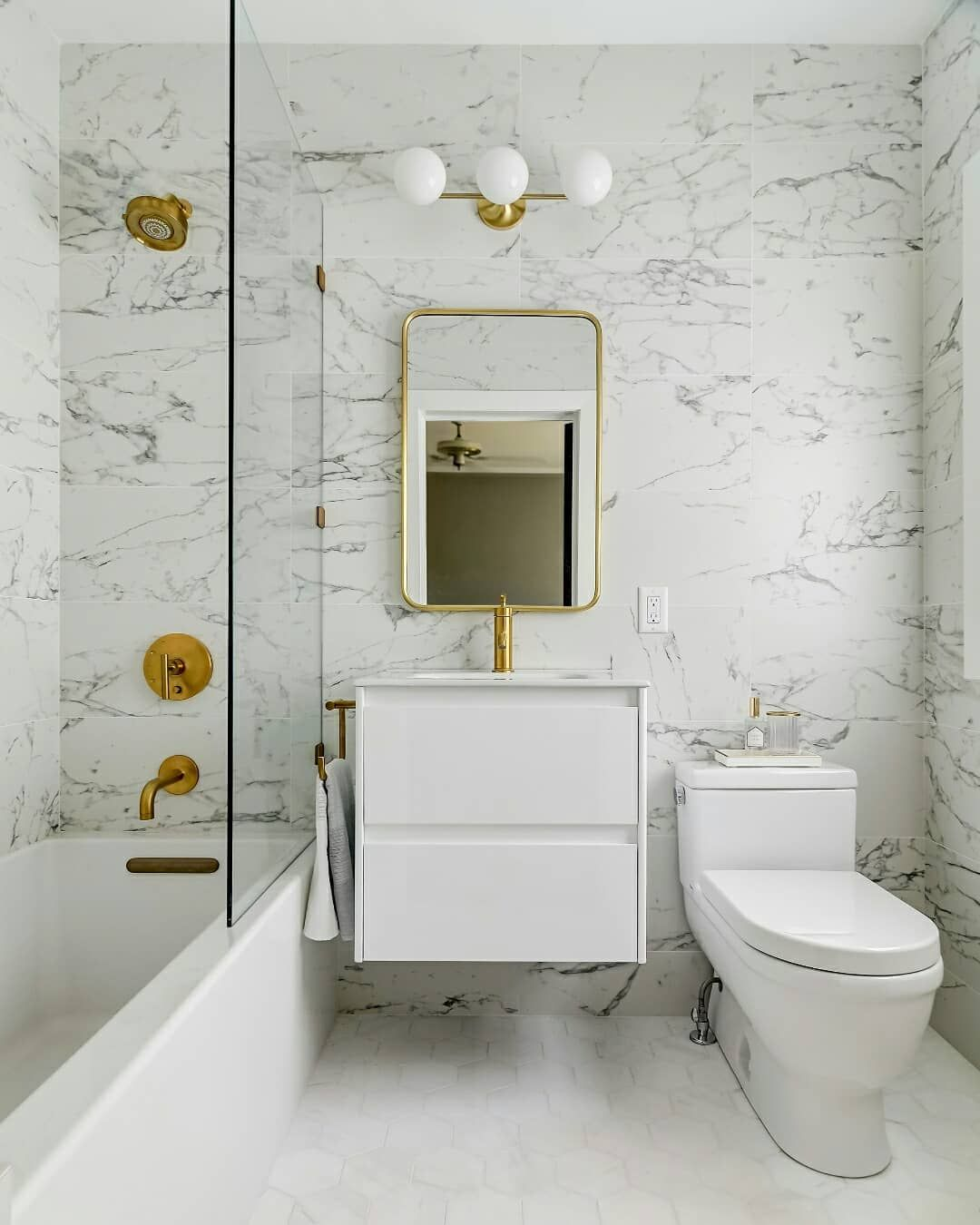 Small Spaces Can Be Glam Too Modern Bathroom Tile Small Bathroom Small Bathroom Tiles