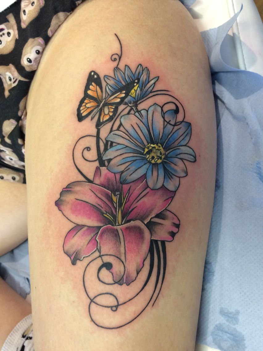 cbb800e22 Flower and butterfly thigh tattoo done by Travis Allen Www.twistedtattoo .co.uk