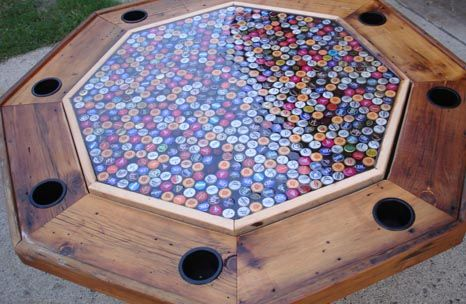 Really cool beer bottle cap poker table! Love the rustic look. I'd love to have a small home bar counter with bottle cap art under glass. (An Irish Pub theme would certainly be involved).