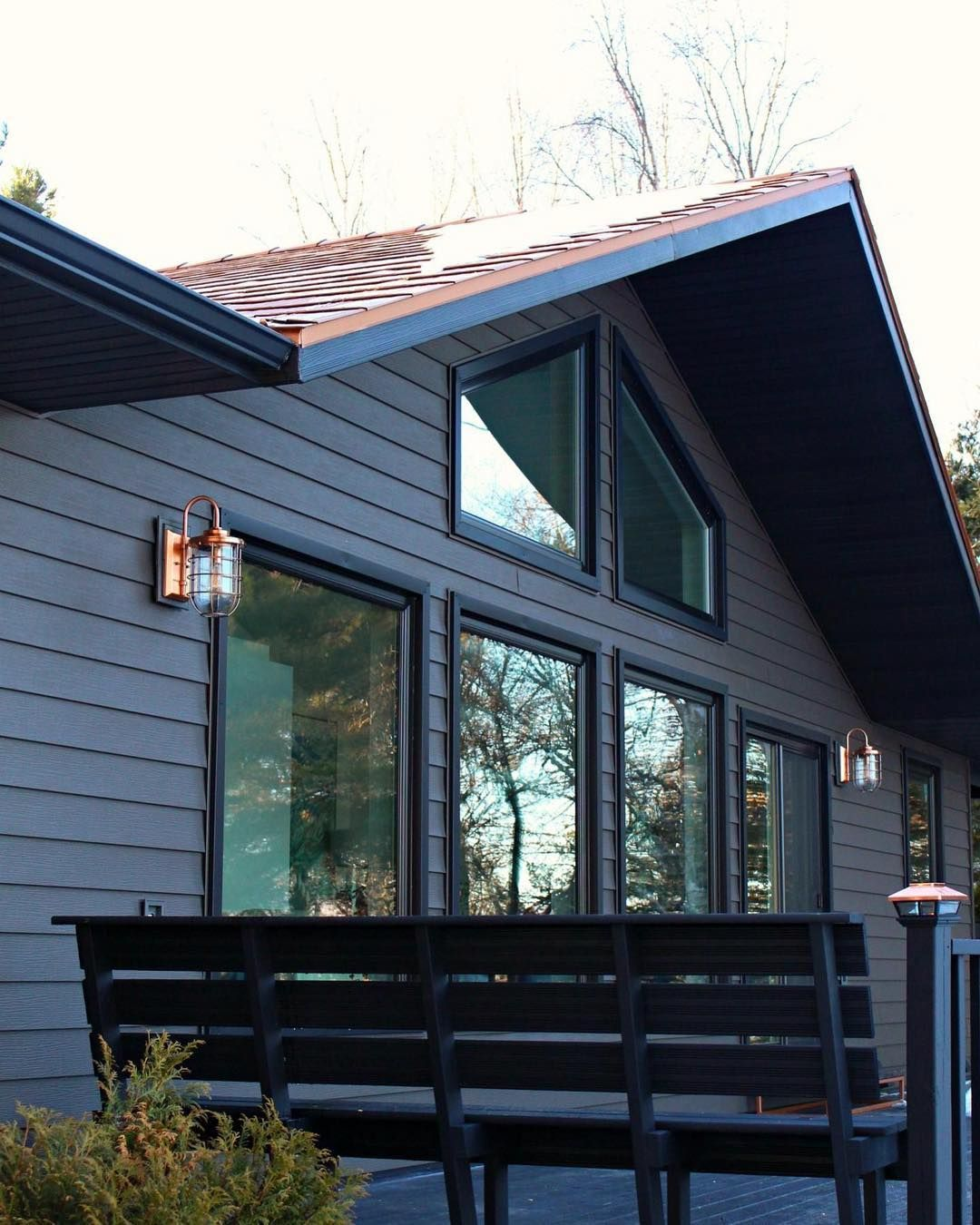 Dark And Moody House Exterior With Copper Roof And Copper Sconces Love The Black Stained Deck Lake Houses Exterior Copper Roof House House Exterior
