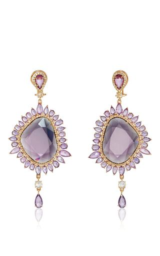 These one of a kind earrings are a statement set from **Sutra**. Set in 18k rose gold for a drop silhouette, they feature a faceted spinel center stone surrounded by purple sapphires and diamond accents.
