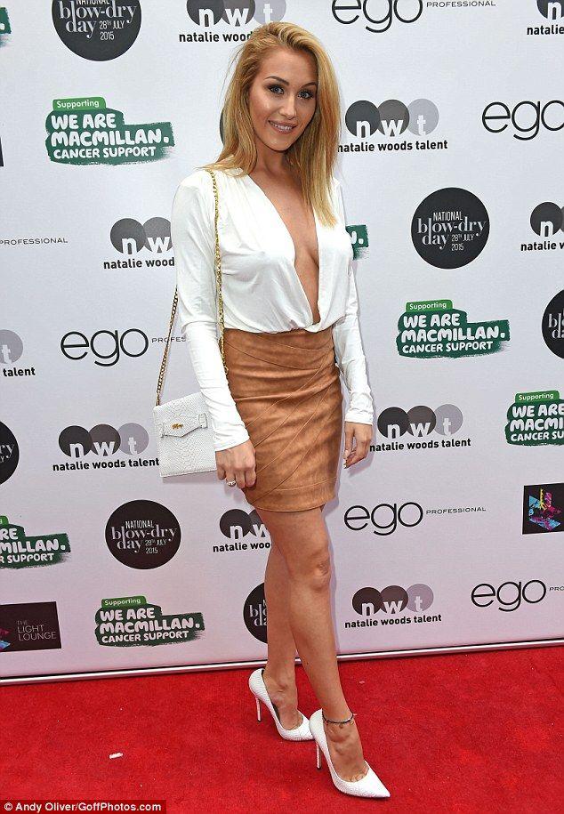 849ef39fd5 Chloe Goodman goes braless in an open cream shirt and tan miniskirt ...
