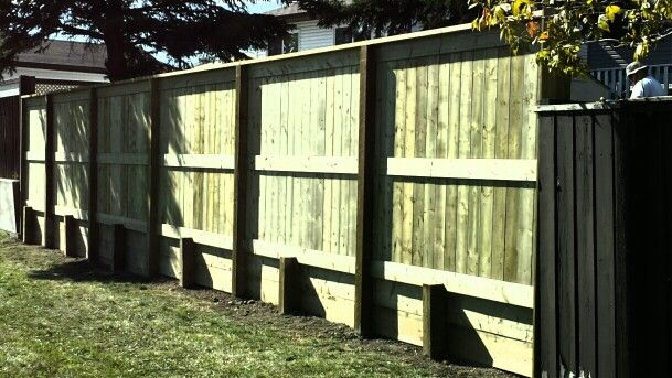 Fortress style 3 pressure treated fence on 4x6 sub post retaining ...