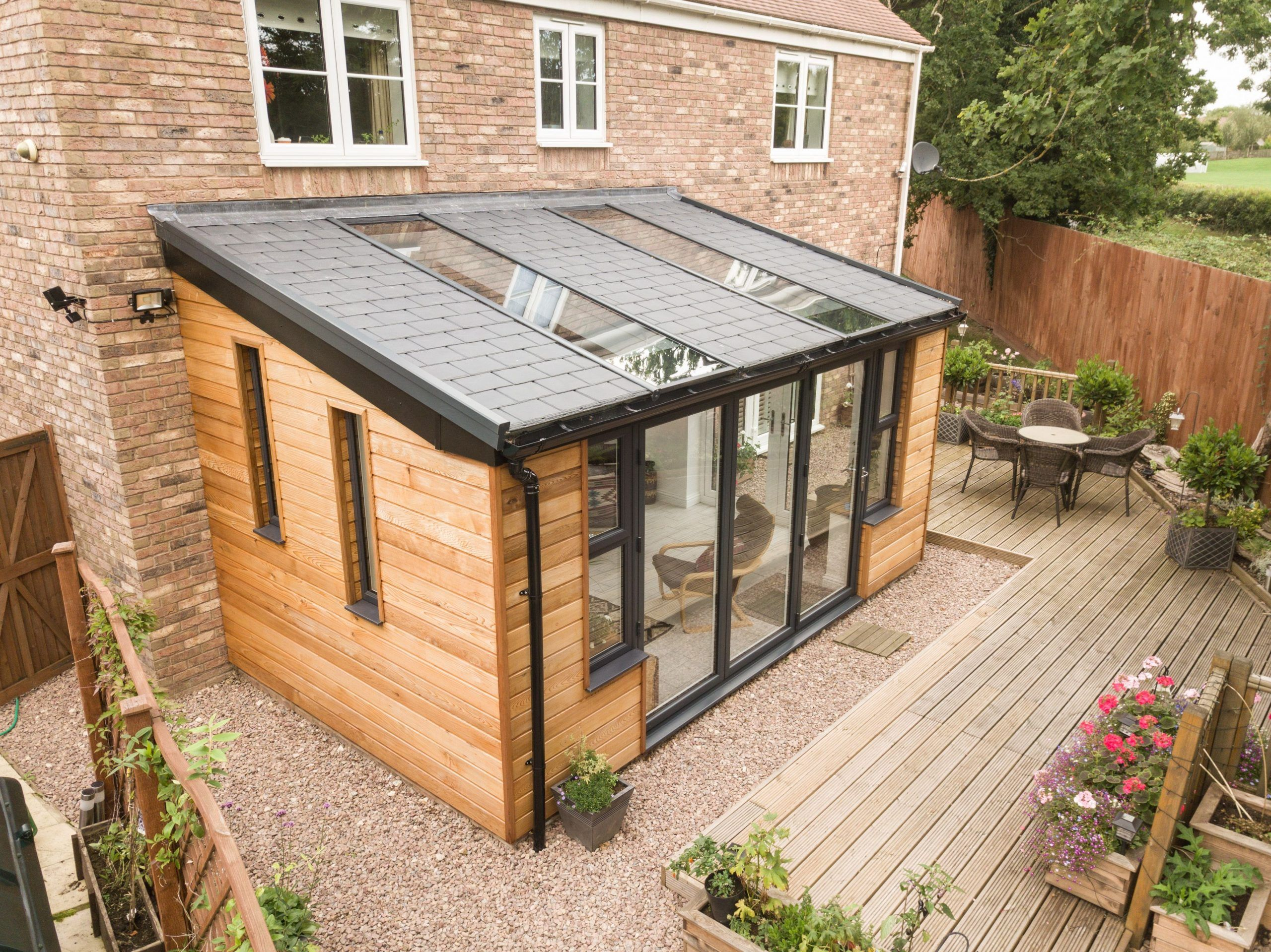 Ultraroof Extension With Cladding Extensionideas Cladding Extension Extensionideas Ul In 2020 Garden Room Extensions Tiled Conservatory Roof House Extension Design