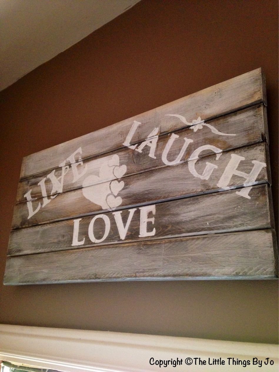 Just hung up live live laugh wood art above my back door rustic