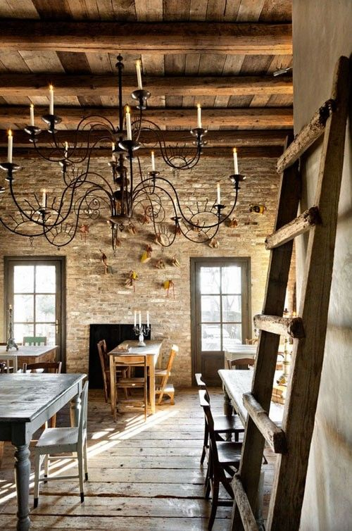 Love The Fancy Chandelier With The Rustic Stone Walls