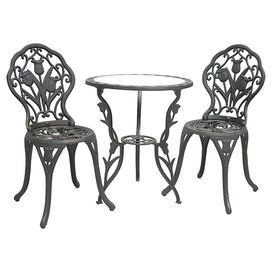 """Indoor/outdoor bistro set with tulip motifs.  Product: 2 Chairs and 1 bistro tableConstruction Material: Cast aluminum, cast iron and glassColor: Antique blackFeatures:  Suitable for indoor and outdoor useTempered, textured glass tabletopPowder-coated finishUV and rust resistant17"""" Seat height each Dimensions: Table: 27"""" H x 23.5"""" DiameterChair: 34"""" H x 17"""" W x 17"""" D each Note: Assembly required"""