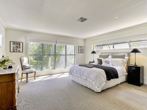 Aluminium Frame Windows White Interior A Spacious Bedroom With Large Bed And Large Windows With