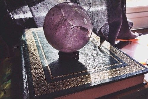 Crystal balls and antique books