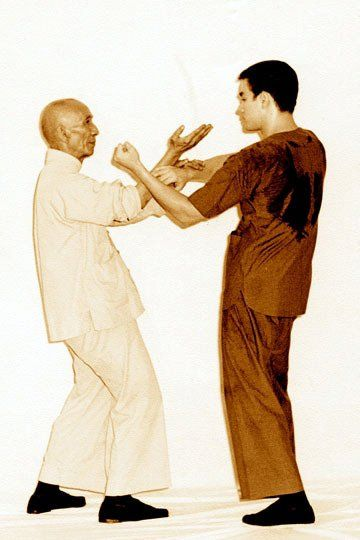 Ip Man and Bruce Lee were probably just posing for the photo but I'm assuming this is how they trained; locked eyes ready for their opponents first move. ~Ip Man & Bruce Lee~