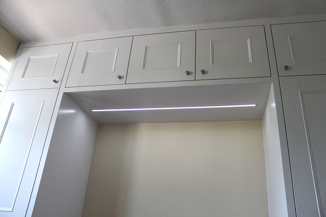 Shaker Wardrobe With Cupboards Above The Bed And Led Light Fitted Bedroom Furniture Fitted Wardrobes Fitted Bedrooms