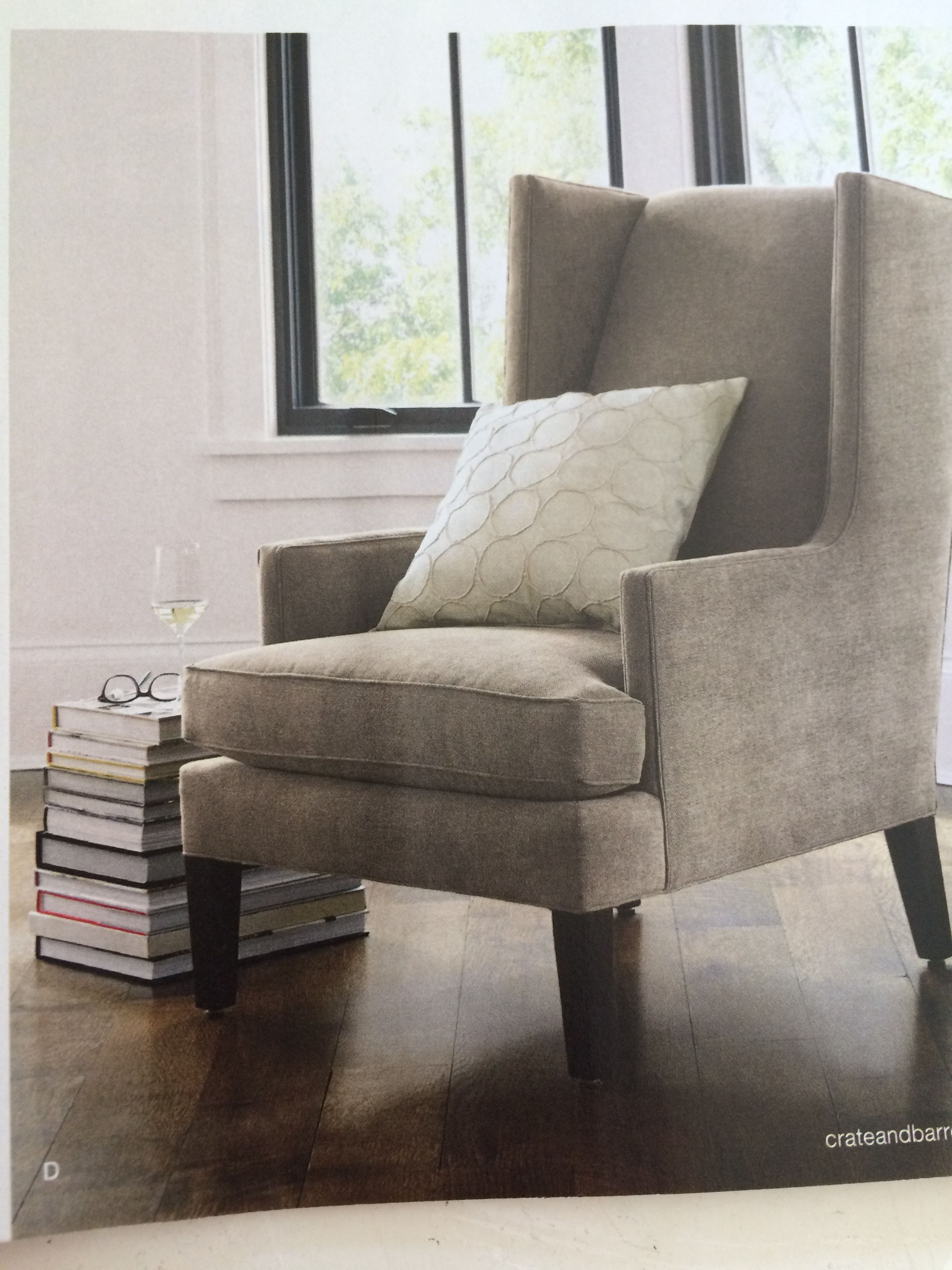 An idea for next to the grey chair instead of a low plant bench... Just get a stack of coffee table books from second- hand stores