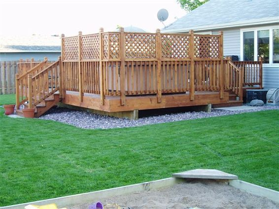 Cedar deck with privacy lattice 03 rock under deck for Outdoor privacy panels for decks