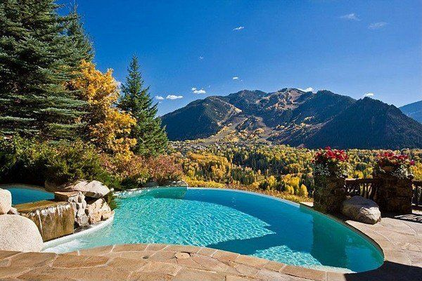 mountain house outdoor pool design ideas waterfall natural stone deck flooring