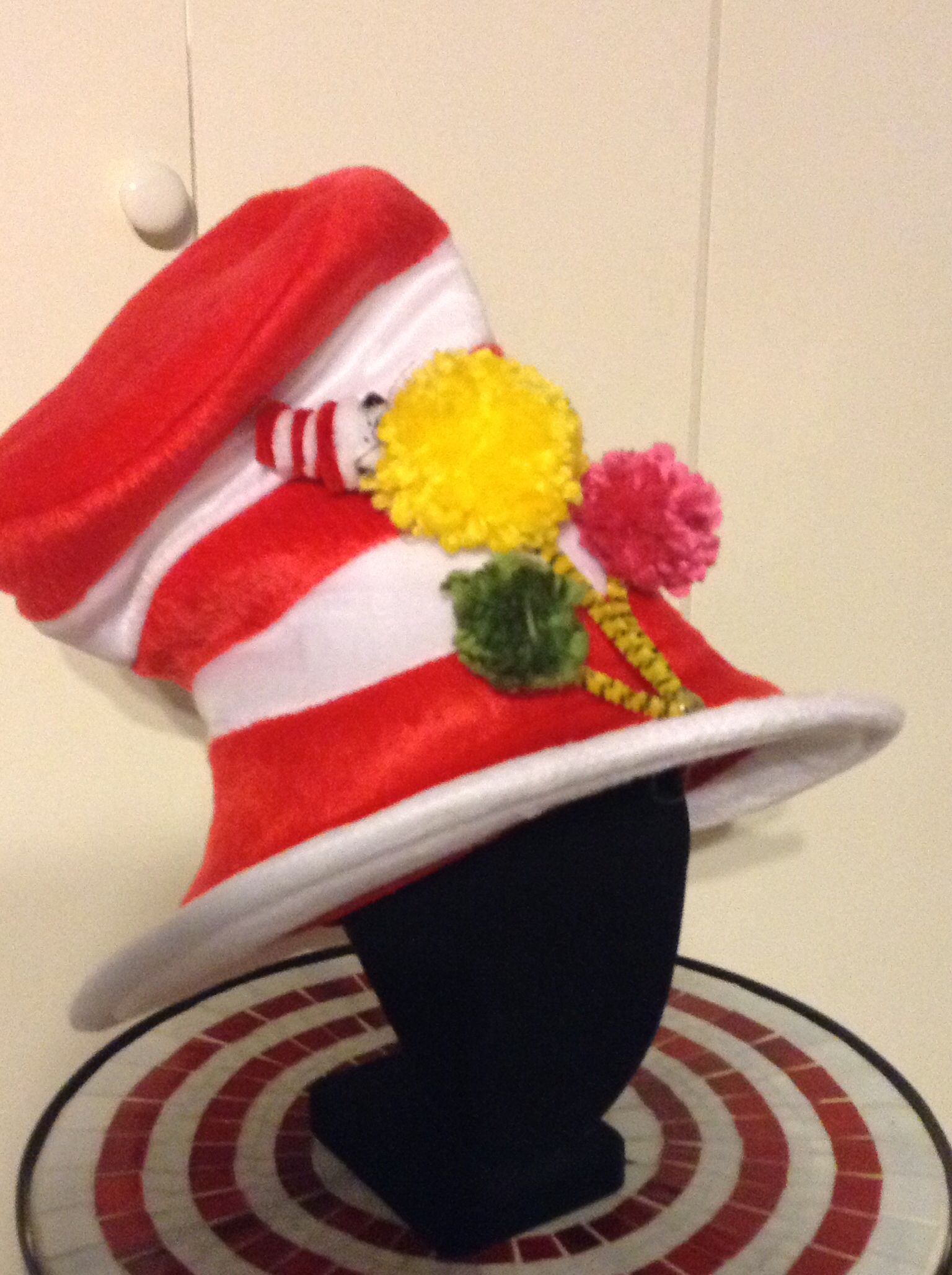 """""""Cat In The Hat"""" super easy party hat. Added pom poms to pipe cleaners to create the truffula trees from """"The Lorax"""". Created cat in the tree from pipe cleaners. Both ideas I found on Pinterest and then added to a store bought hat."""