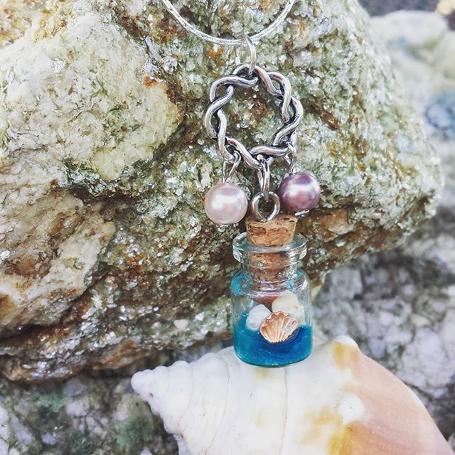 By The Sea Necklace . Message in A Bottle holds sand, tiny shells I've collected & two copper shells. On a silver plated chain with pearl charms