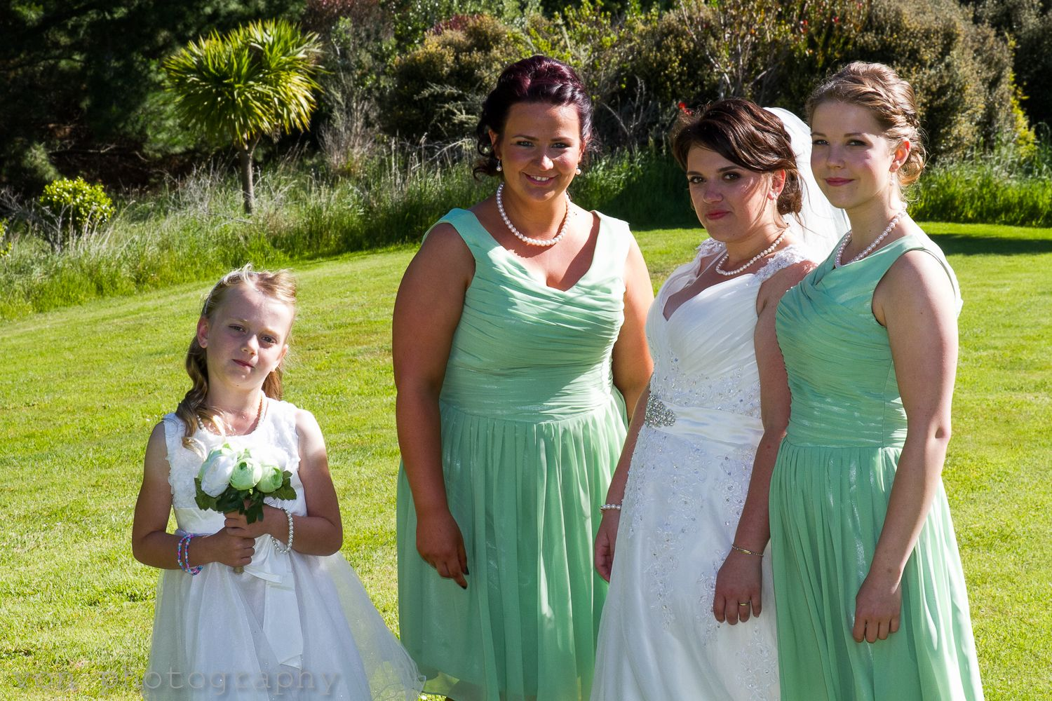 Bride and Bridesmaids Mint Green dresses  Image by Wellington wedding photographer David from Von photography www.wellingtonphotography.net