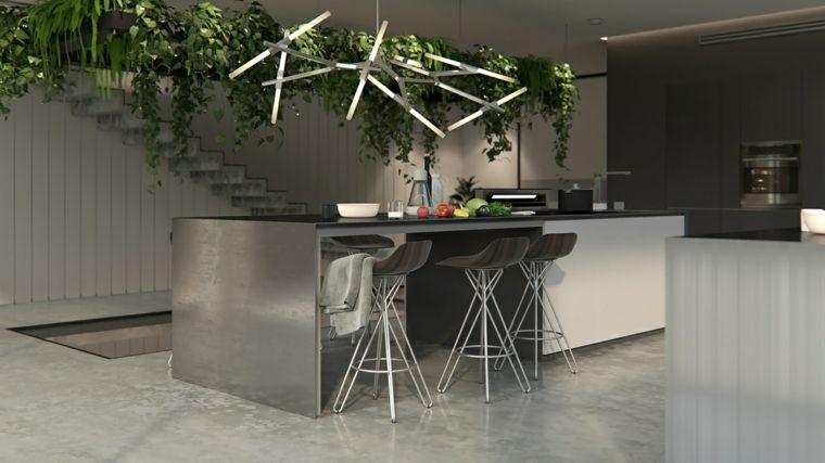 Illuminazione originale sopra l isola cucina attrezzata con tavolo