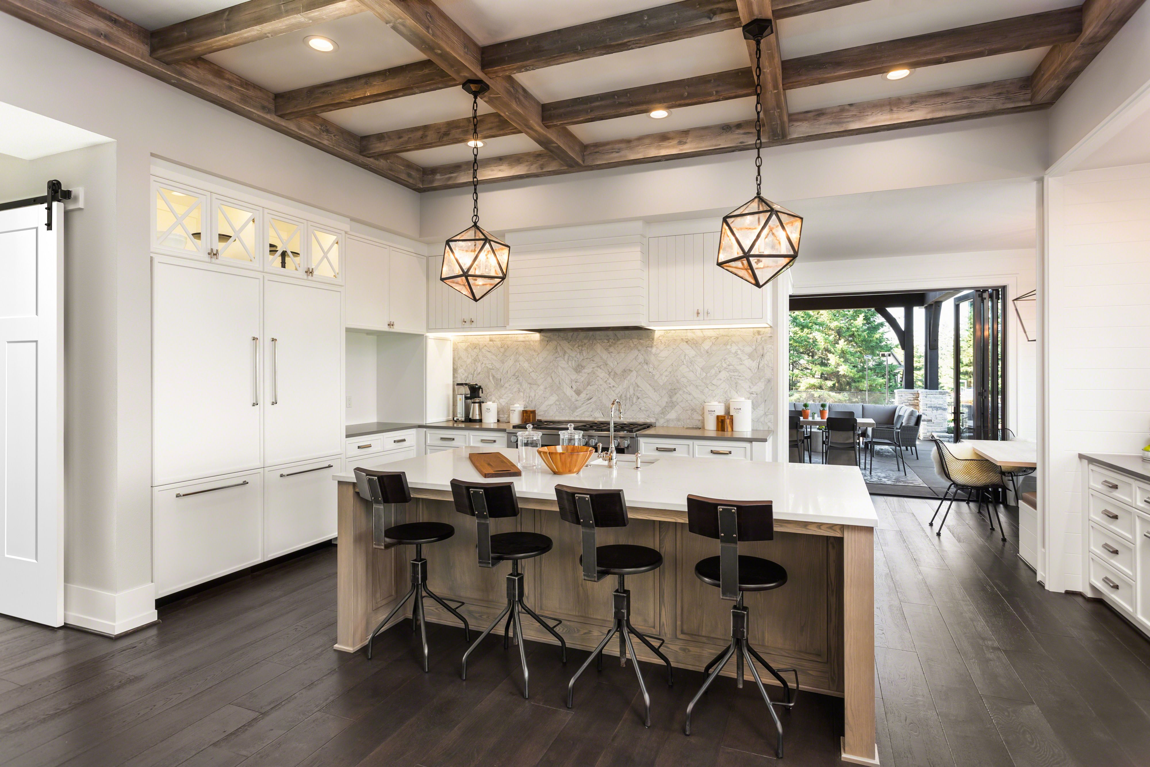 White Craftsman Style Open Concept Kitchen With Wooden Ceiling Beam Accents And A White Shaker Door Craftsman Style Kitchen Kitchen Interior Shaker Doors