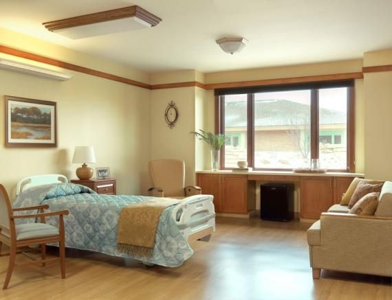 Hospice Centers Provide Patients, Families With Home Away From Home | Environments for Aging --- The patient rooms at OSF Richard L. Owens Hospice are roomy with large bay windows and faux-wood flooring. Photo: Alise O'Brien Photography.