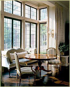 White Trim With Black Window Frames And Colonial Grids