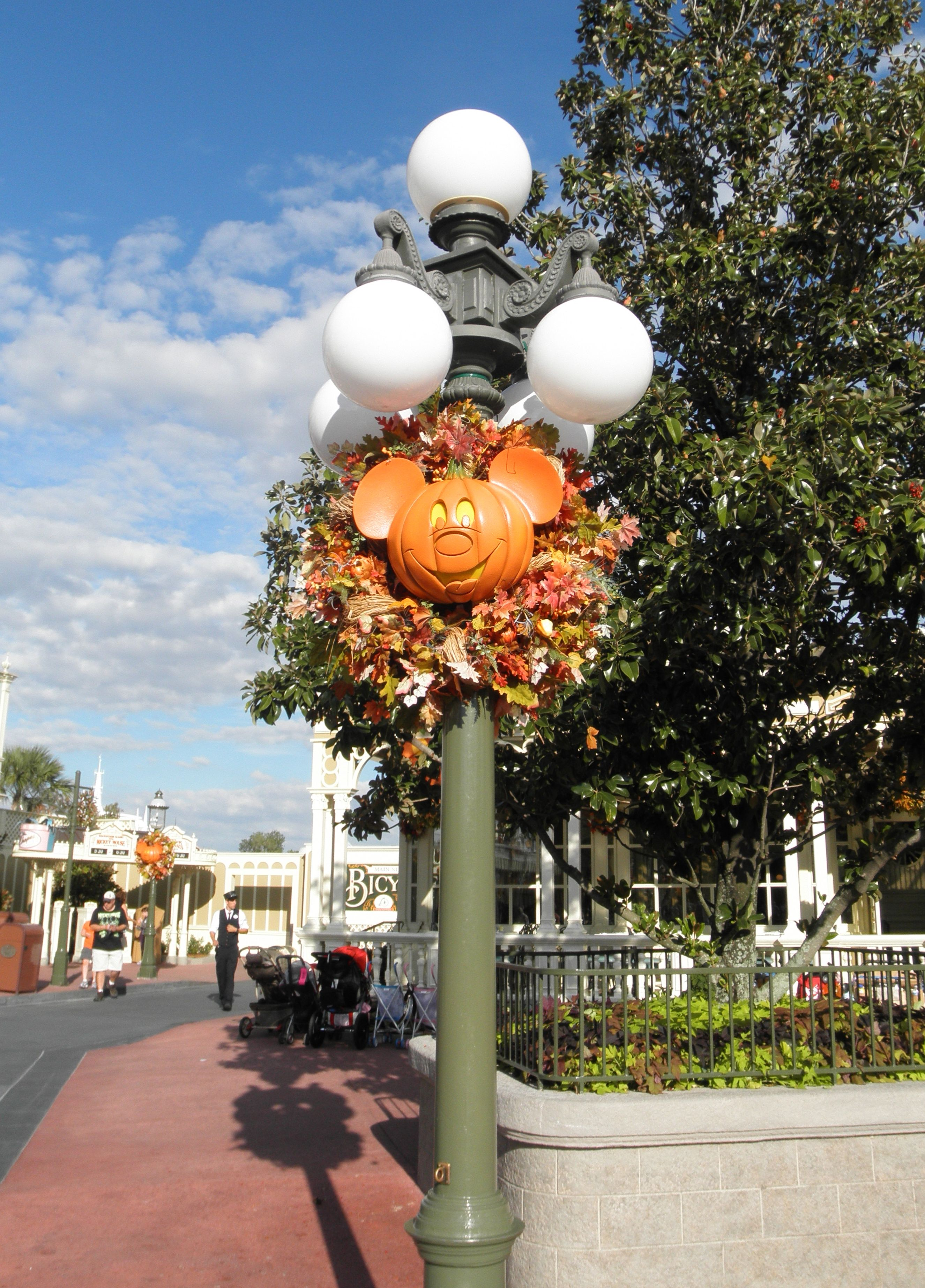 The Lamp Posts Are Decorated With Jack O Lantern Mickey S At Magic Kingdom Disney Halloween Mickey Halloween Party Disneyland Halloween