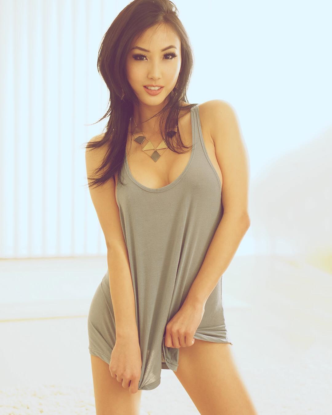 Asian sexy woman with big breast in black bikini on the bed