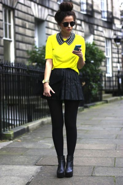 Black collar necklace, a yellow shirt, a black skirt, black ...