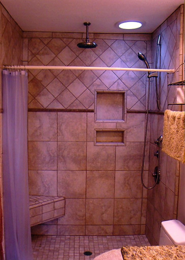 niches in shower stalls | Shower Stall with Porcelain Tile, bench ...