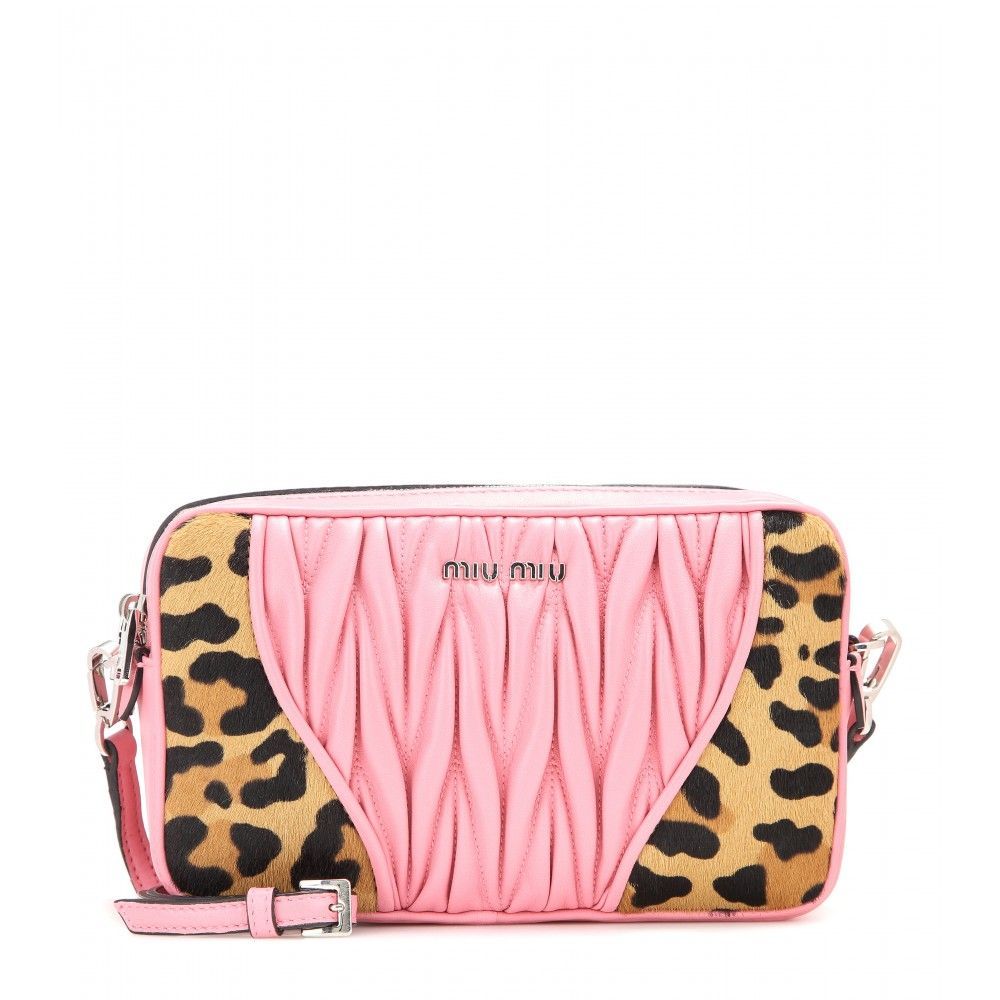 Miu Miu - Matelassé leather and printed calf hair shoulder bag - Miu Miu's matelassé leather candy-pink shoulder bag is updated this season with panels of animal-printed calf hair for a statement look. The signature logo lettering keeps the bold look recognisable. Carry it over your shoulder next to a pretty dress. seen @ www.mytheresa.com