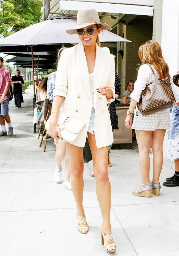 38836e2f6be How Chrissy Teigen Looks Polished in Distressed Denim Shorts ...
