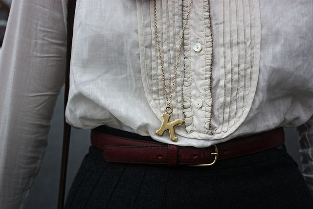 mini pleated blouse and letter pendant. looking refined.
