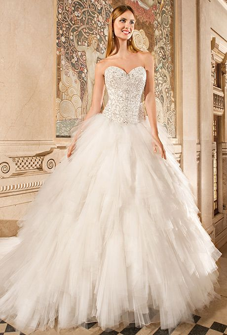 Brides: Demetrios - Ilissa. This unique ball gown features a magnificent bodice adorned with elaborate beaded embroidery with jeweling and a full multi-tiered tulle skirt. The back features a corset lace-up and chapel train.