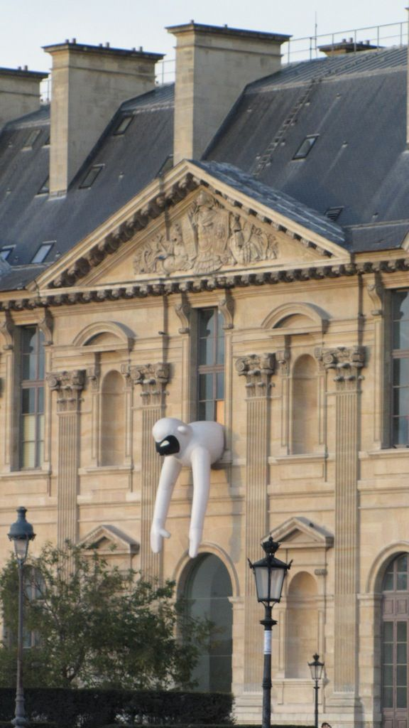 Hanging out of the Louvre. Paris, France.