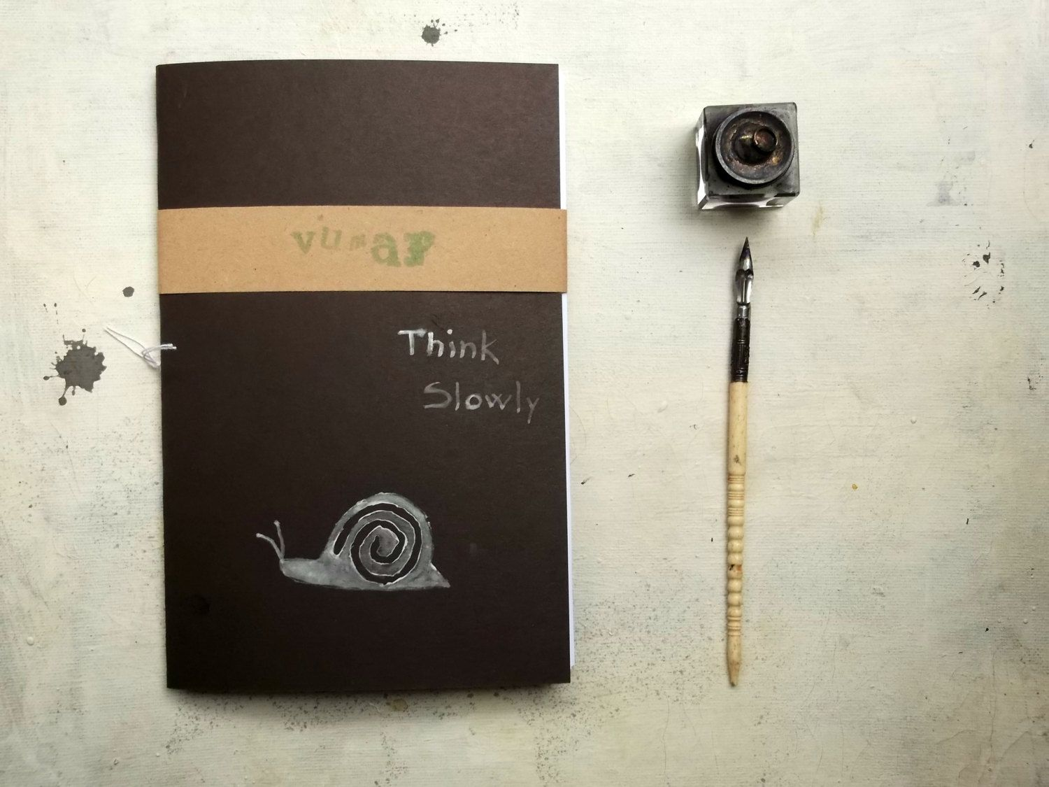 think slowly journal sketchbook , hand  Stitched, black cover, travel Journal with snail by vumap on Etsy