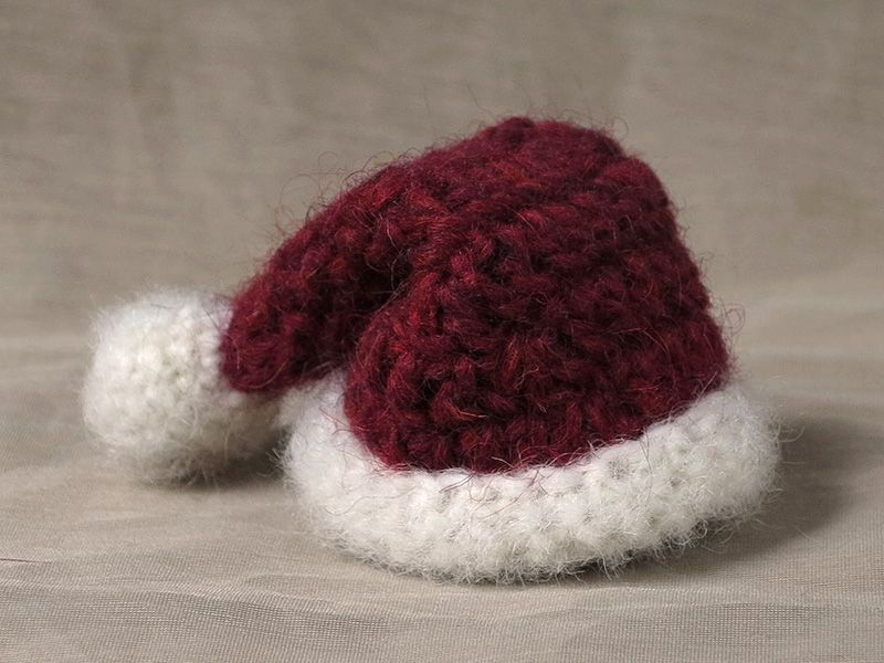 crochet santa hat. With some modification could use for jam toppers ...