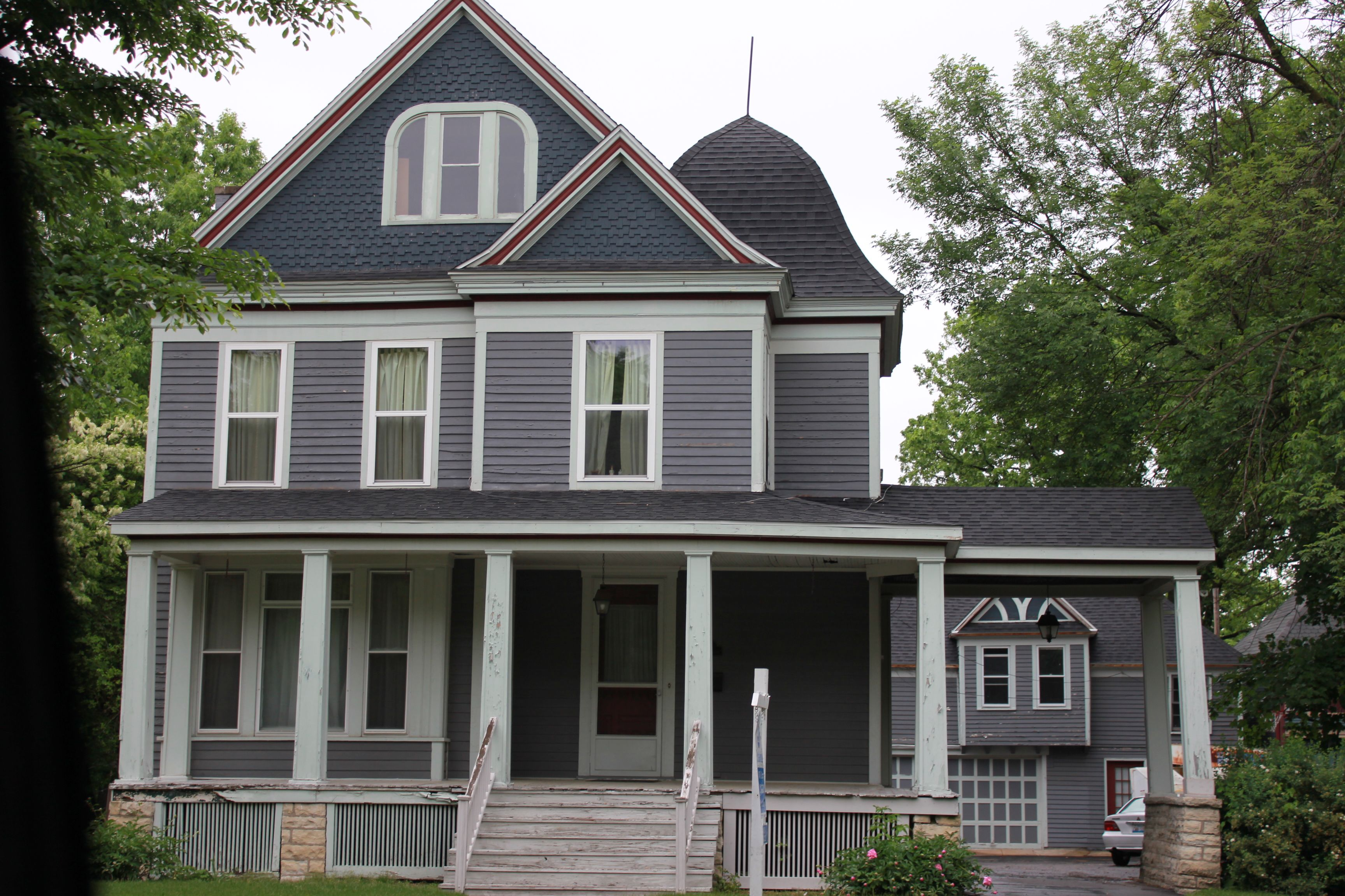 victorian mansion with original carriage house on western avenue